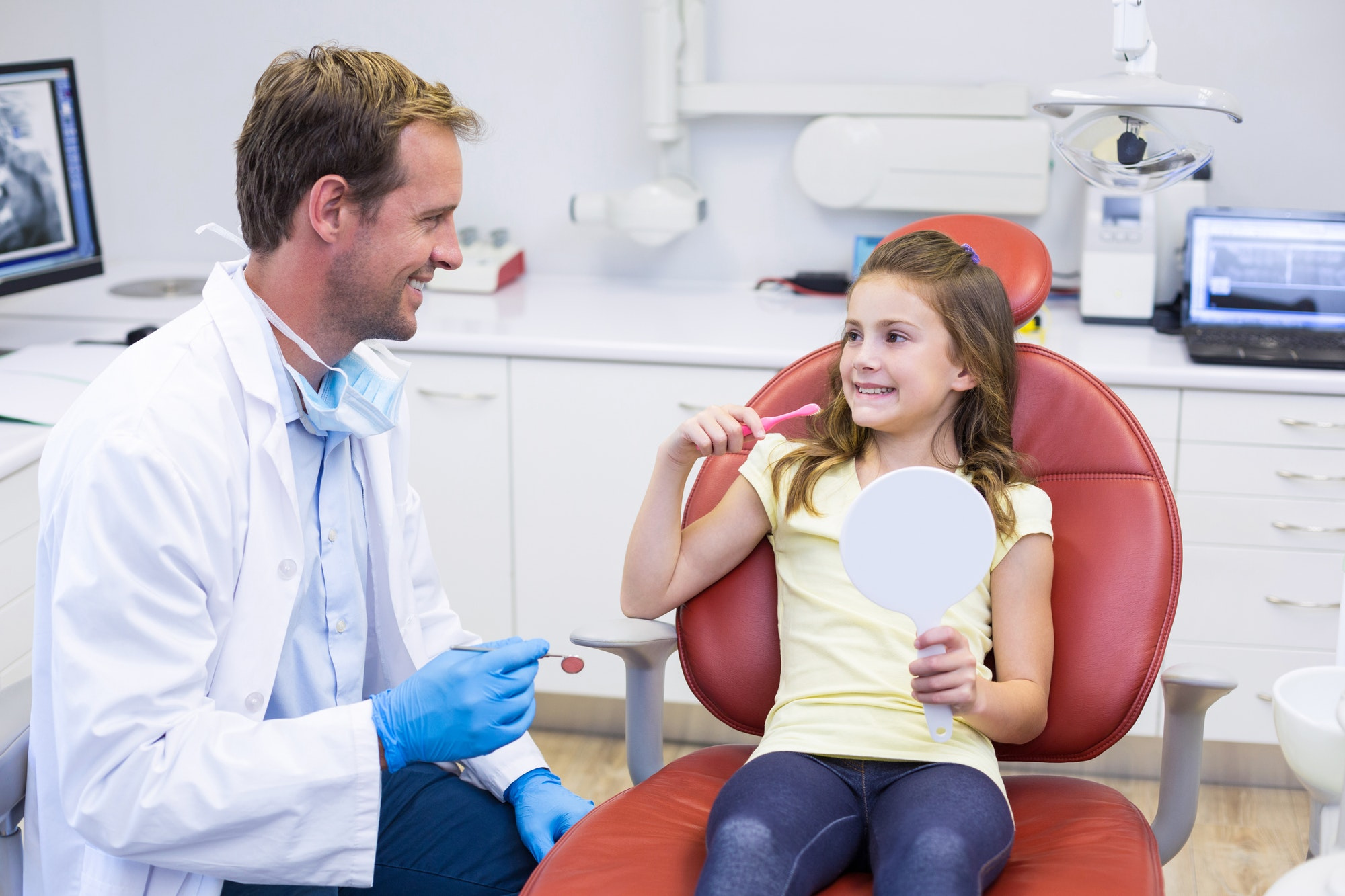 Young patient interacting with dentist in dental clinic